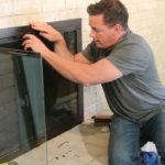 glass fireplace screens with doors photo